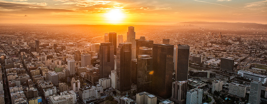 Picture of Los Angeles from overhead during sunrise.